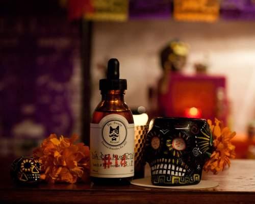This is a bottle of Dr. Sours Mexican Cocktail Bitter #14 - Dia de Muertos
